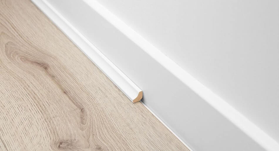 White scotia with wood effect laminate flooring