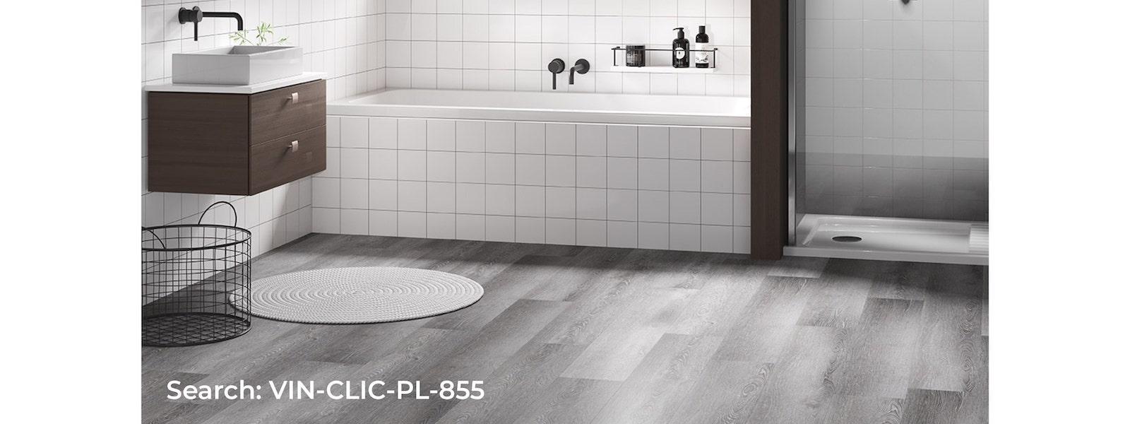 Spacious bathroom with grey toned vinyl