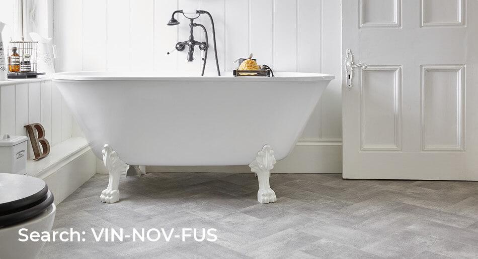 Bathroom with Nova Fusion herringbone wood effect sheet vinyl flooring