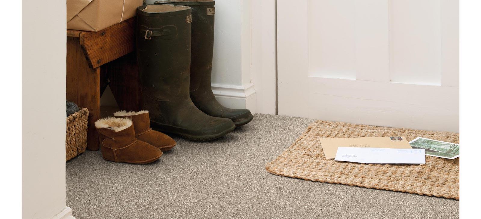 boots next to hallway doormat