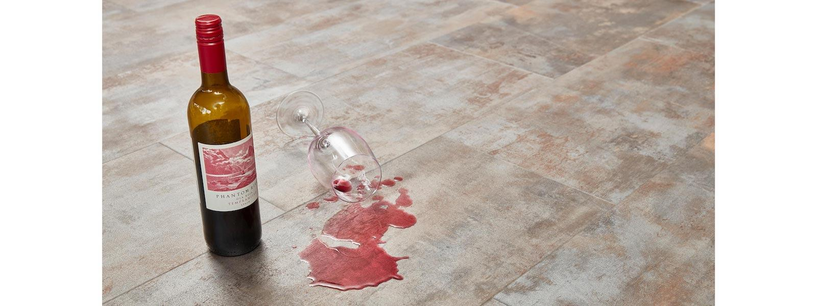 wine bottle and spilled glass