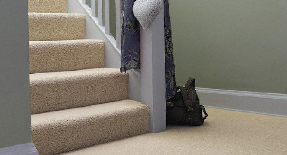 Cream coloured carpet on the stairs and hallway, creating a light and open look
