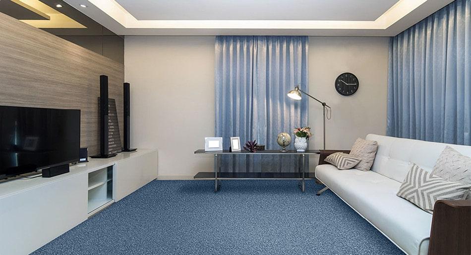 Blue carpet, neutral coloured living room