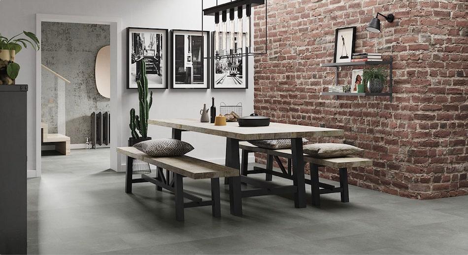 dining room with brickwork
