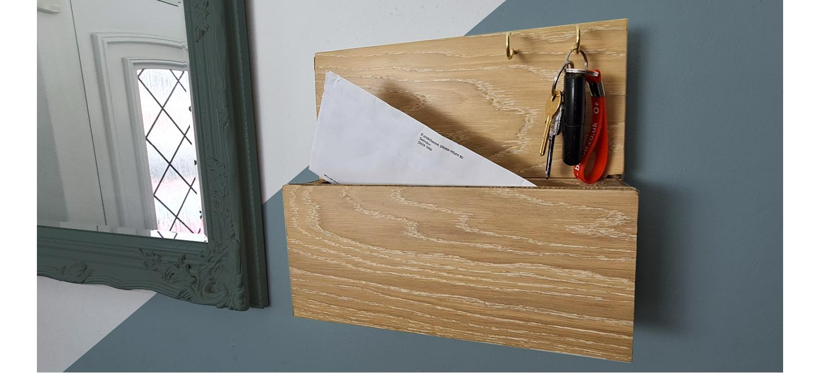 wooden letter caddy on wall