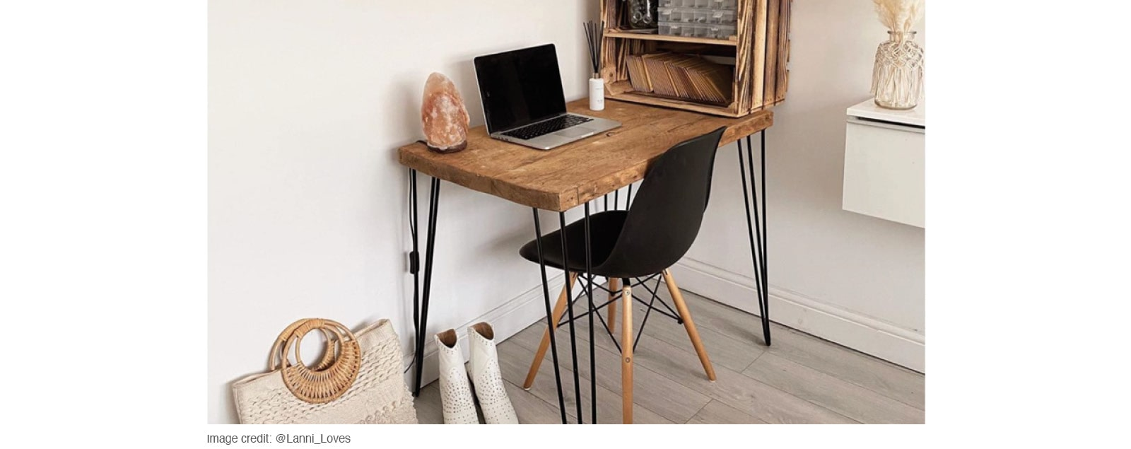 white walled home office with natural wood desk