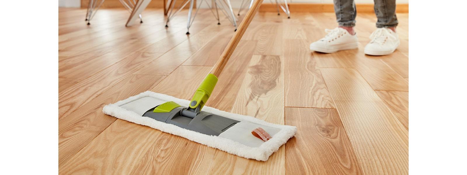 wood floor being swept