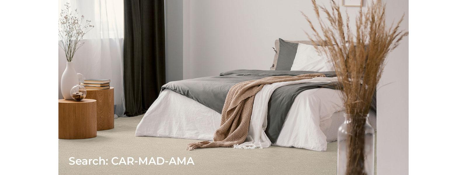 bedroom with beige carpet