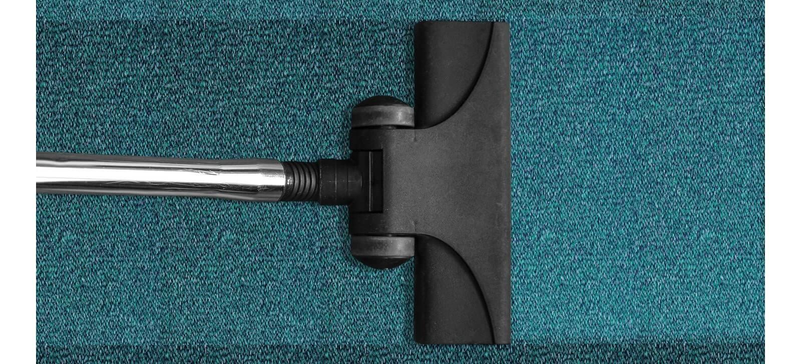 blue carpet and vaccum cleaner