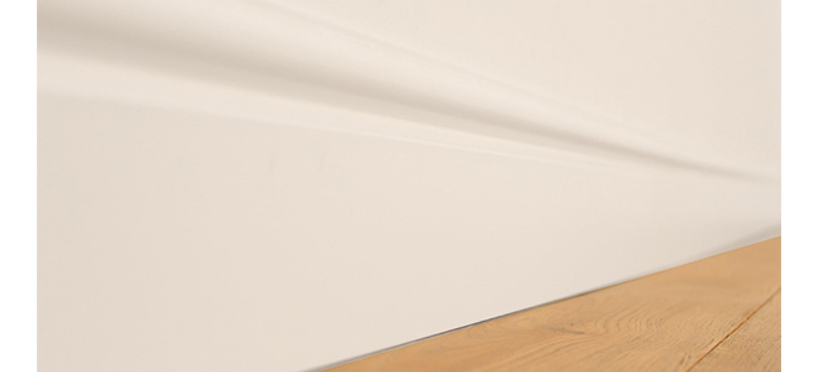 White skirting with wooden floor